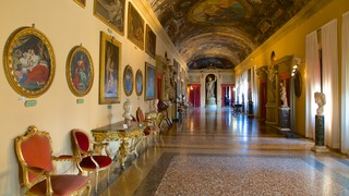 Palazzo Comunale featuring art, a castle and interior views