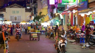 Ben Thanh Market which includes street scenes, markets and night scenes