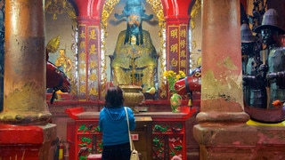 Jade Emperor Pagoda featuring religious elements, a temple or place of worship and interior views
