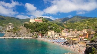 Monterosso Beach which includes a coastal town, general coastal views and a sandy beach