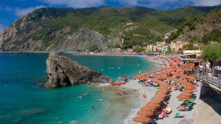 Monterosso Beach which includes a sandy beach, a luxury hotel or resort and general coastal views