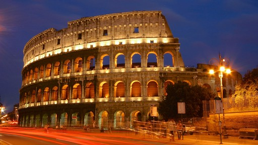 Colosseum which includes night scenes, heritage elements and a monument