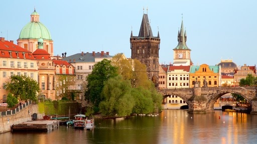 Charles Bridge which includes a bridge, a river or creek and a city