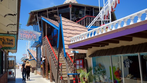Redondo Beach which includes a coastal town and signage as well as a couple