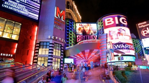 Miracle Mile Shops which includes night scenes, signage and a casino