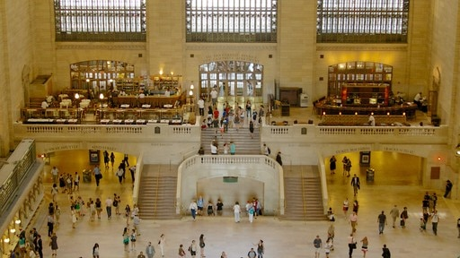 Grand Central Terminal featuring heritage architecture and interior views as well as a large group of people