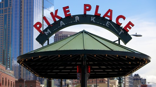 Pike Place Market which includes signage, markets and a city