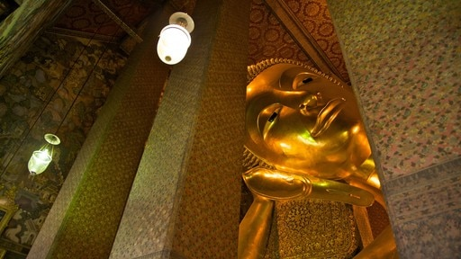 Wat Pho featuring interior views and religious aspects