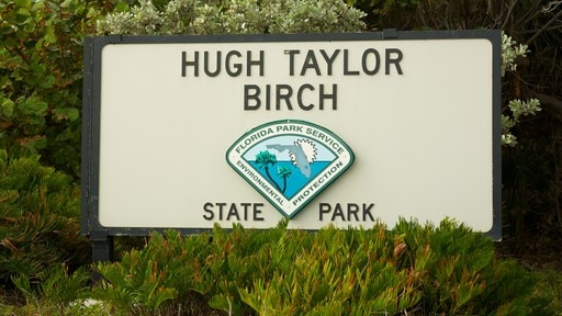 Hugh Taylor Birch State Park which includes signage and a garden