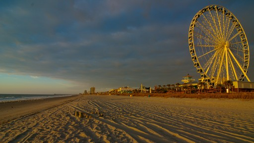 SkyWheel Myrtle Beach showing a sandy beach and a sunset