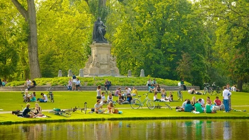 Vondelpark featuring a pond, landscape views and a statue or sculpture