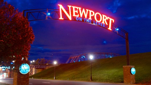 Newport on the Levee featuring night scenes and signage