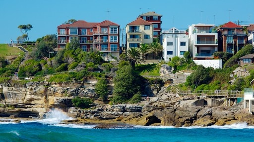 Bondi Beach showing rocky coastline, a house and a coastal town