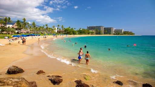 Kaanapali Beach showing a beach, swimming and a coastal town