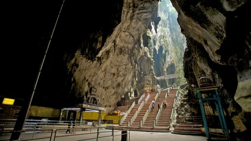 Batu Caves featuring interior views, caves and landscape views