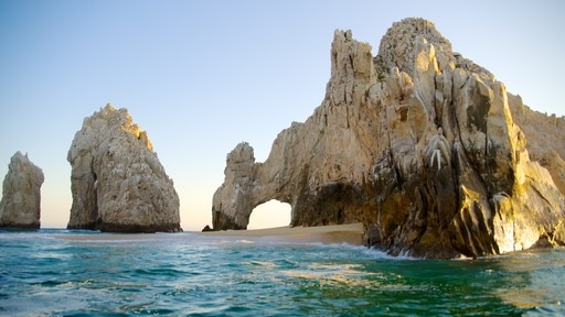 El Arco featuring a sandy beach and rocky coastline