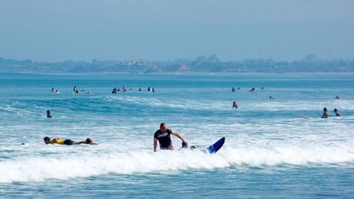 Kuta Beach which includes surfing, surf and swimming