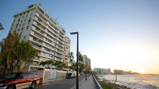 Condado Beach which includes general coastal views, street scenes and a coastal town