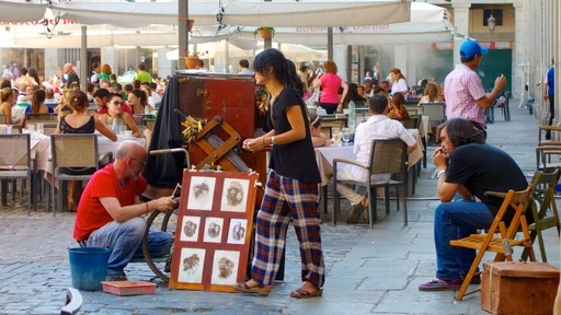 Plaza Mayor featuring cafe scenes, a square or plaza and street performance