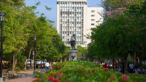 Plaza de Bolivar which includes a park and a statue or sculpture