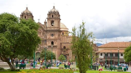 Plaza de Armas featuring a garden and a church or cathedral