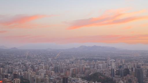 San Cristobal Hill featuring a sunset and a city