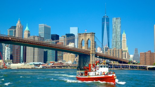 Brooklyn Bridge featuring a ferry, a river or creek and a bridge