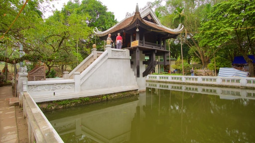 One Pillar Pagoda showing a garden and a pond