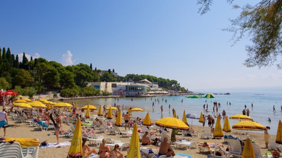 Bacvice Beach showing general coastal views as well as a large group of people