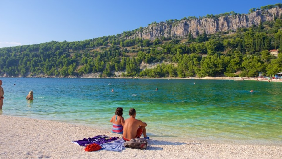 Kasuni Beach which includes general coastal views and a beach as well as a couple