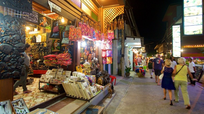 Fisherman\'s Village showing shopping and night scenes as well as a large group of people