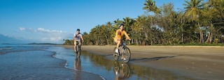 Mission Beach featuring mountain biking and a sandy beach as well as a small group of people