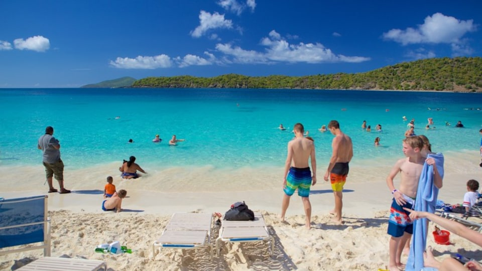 Coki Beach which includes a beach as well as a small group of people