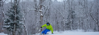 Mont-Tremblant Ski Resort showing snow skiing and snow as well as an individual male