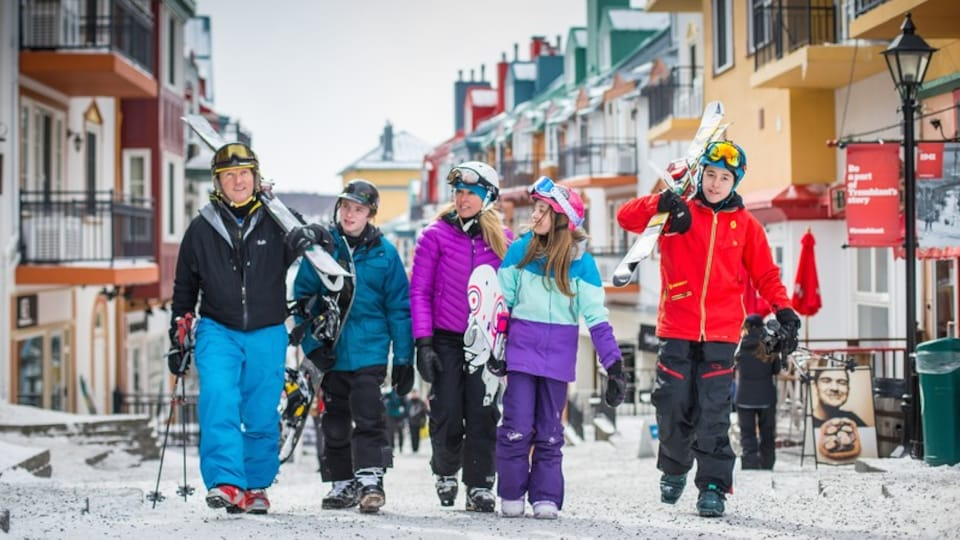 Mont-Tremblant Ski Resort which includes a city and snow as well as a family