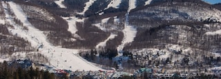 Mont-Tremblant Ski Resort featuring mountains and snow