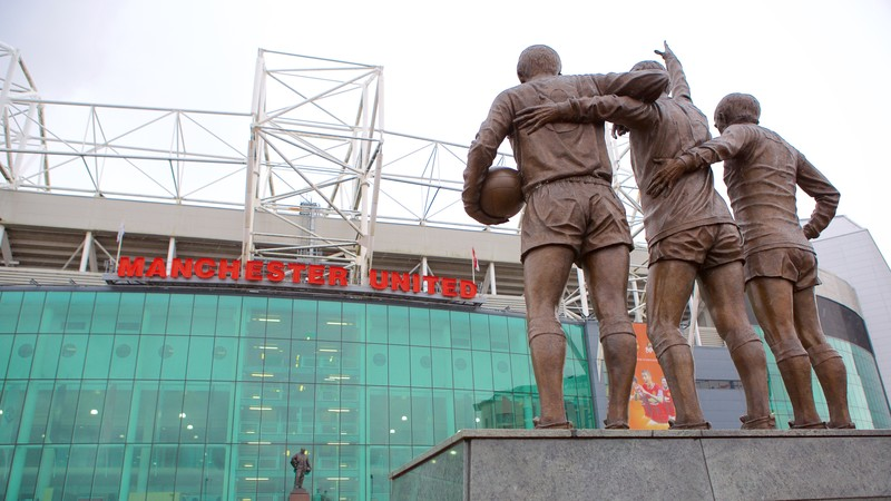 Old Trafford which includes a statue or sculpture