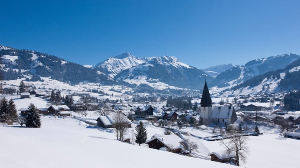 Gstaad featuring snow and a small town or village