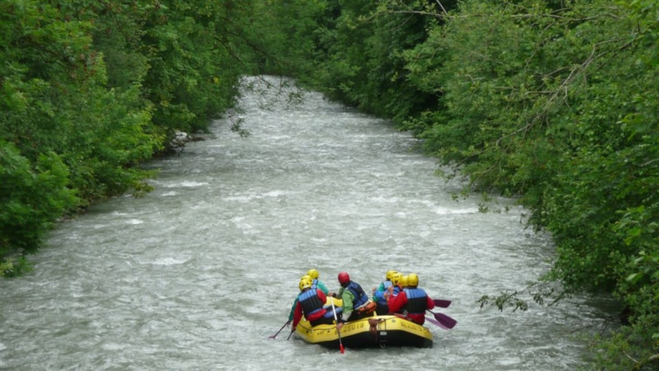 Gstaad featuring kayaking or canoeing and a river or creek