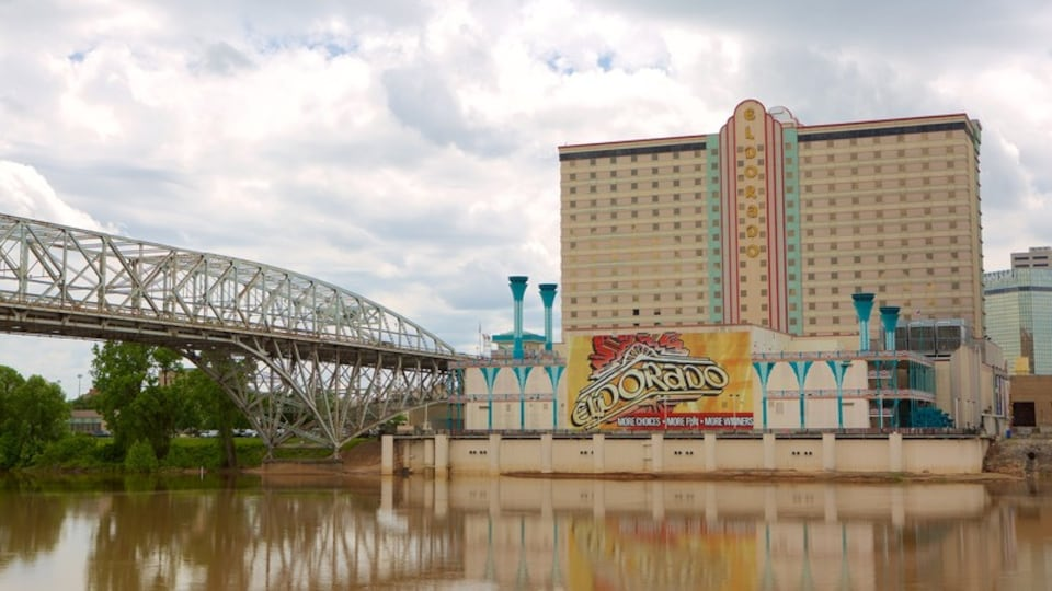 Louisiana Boardwalk featuring a bridge and a river or creek