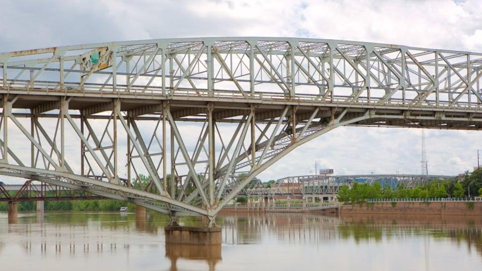Louisiana Boardwalk showing a river or creek and a bridge