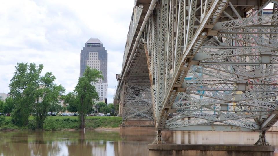 Louisiana Boardwalk featuring a river or creek and a bridge