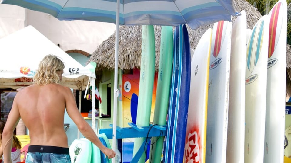 Sayulita showing surfing as well as an individual male