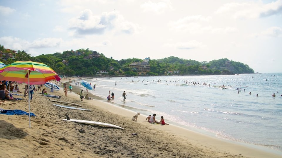 Sayulita which includes swimming and a beach as well as a large group of people