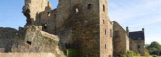 Aberdour Castle featuring chateau or palace, building ruins and heritage elements