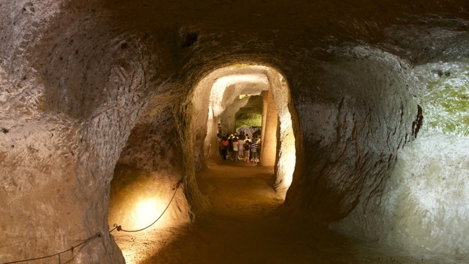 Etruscan Orvieto Underground showing interior views and caves as well as a small group of people