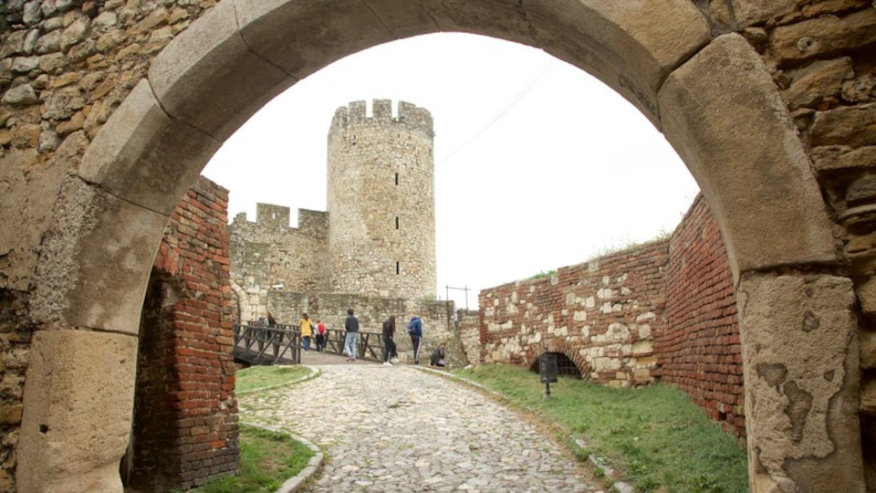 Kalemegdan Citadel featuring a bridge and heritage elements as well as a small group of people