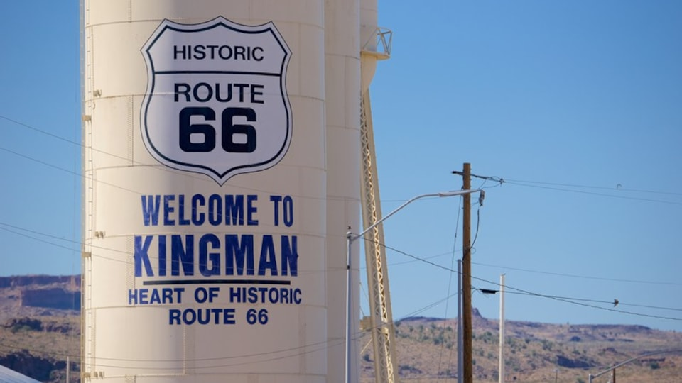 Kingman which includes desert views, signage and tranquil scenes