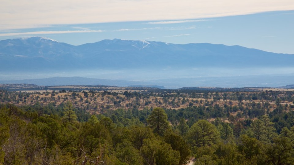Puye Cliff Dwellings featuring landscape views, tranquil scenes and mist or fog