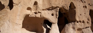 Puye Cliff Dwellings which includes building ruins and heritage elements